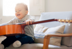 Toddler playing the guitar