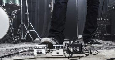 Guitarist using a footpedal