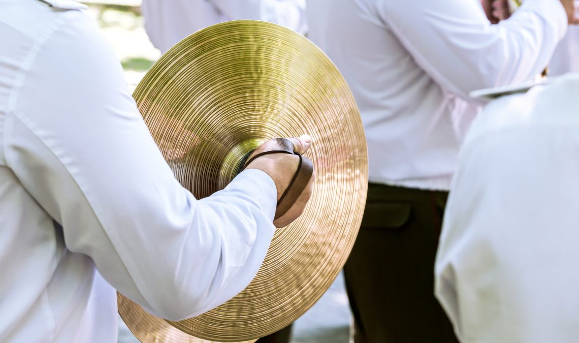 Musician plays cymbal at the festival of brass bands